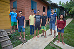 Young adults in a residential program for indigenous students pose in front of their cabins in Atalaia do Norte, Brazil. The program, run by an evangelical pastor, hosts indigenous young adults from throughout the Amazon region.