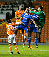 Portsmouth's Luke McGee collides with Christian Burgess in punching a ball clear<br /> <br /> Photographer Alex Dodd/CameraSport<br /> <br /> The EFL Sky Bet League One - Blackpool v Portsmouth - Saturday 11th November 2017 - Bloomfield Road - Blackpool<br /> <br /> World Copyright &copy; 2017 CameraSport. All rights reserved. 43 Linden Ave. Countesthorpe. Leicester. England. LE8 5PG - Tel: +44 (0) 116 277 4147 - admin@camerasport.com - www.camerasport.com