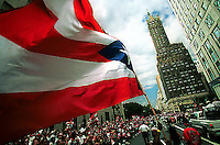 The Puerto Rican flag waves proudly along 5th avenue Sunday as the annual Puerto Rican Day parade makes its way up the famous New York City avenue.  June 2001.
