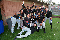 Batavia Muckdogs Albert Guaimaro, Julio Frias, Ronal Reynoso, Edgar Martinez, Dalvy Rosario, Andres Sthormes, Joey Steele, Jonaiker Villalobos (standing);  Michael Hernandez, Edison Suriel, Geremy Galindez (kneeling); and Julian Infante (on ground) celebrate after clinching the Pinckney Division Title during a NY-Penn League game against the Auburn Doubledays on September 2, 2019 at Falcon Park in Auburn, New York.  Batavia defeated Auburn 7-0 to clinch the Pinckney Division Title.  (Mike Janes/Four Seam Images)
