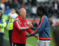 Pictured L-R: Alan Curtis congratulates Bafetimbi Gomis after the end of the game Sunday 30 August 2015<br /> Re: Premier League, Swansea v Manchester United at the Liberty Stadium, Swansea, UK