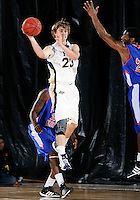 Florida International University guard Tanner Wozniak (23) plays against Florida Memorial University in an exhibition game .  FIU won the game 86-69 on November 9, 2011 at Miami, Florida. .