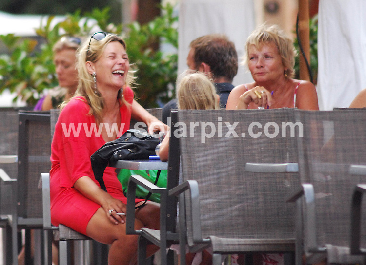 **ALL ROUND EXCLUSIVE PICTURES FROM SOLARPIX.COM**.**WORLDWIDE SYNDICATION RIGHTS EXCLUDING SPAIN - NO PUBLICATION IN SPAIN & PORTUGAL**.Kate Moss and her daughter Lila Grace pictured in Ibiza with leading fashion photographer Marcus Piggott & her Nanny. Kate bought an ice cream for her 5 year old daughter but decided not to have one herself, sticking to cigarettes instead. Ibiza, Spain. 30th July 2008..JOB REF: 6935 IBZ       DATE: 30_07_2008.**MUST CREDIT SOLARPIX.COM OR DOUBLE FEE WILL BE CHARGED* *UNDER NO CIRCUMSTANCES IS THIS IMAGE TO BE REPRODUCED FOR ANY ONLINE EDITION WITHOUT PRIOR PERMISSION*