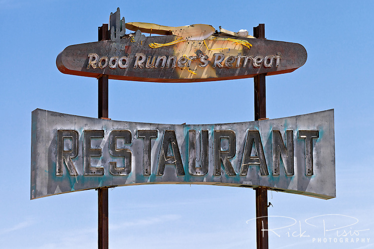The neon sign for the abandoned Roadrunner Cafe and Gas Station, which lies between Chambless and Amboy in California's Mojave Desert, sits exposed to the desert elements.