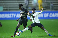 CARY, NC - DECEMBER 13: Irakoze Donasiyano #11  of University of Virginia tries to tackle the ball away from Joey DeZart #14 of Wake Forest University during a game between Wake Forest and Virginia at Sahlen's Stadium at WakeMed Soccer Park on December 13, 2019 in Cary, North Carolina.