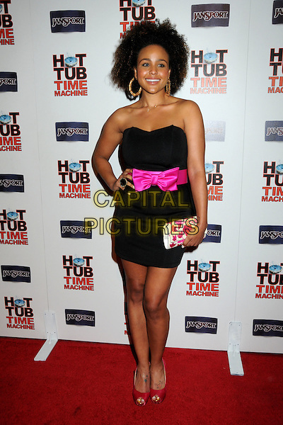 "HAYLEY MARIE NORMAN.""Hot Time Time Machine"" World Premiere Party held at the Cabana Club, Hollywood, California, USA..March 17th, 2010.full length black strapless mini dress pink sash bow ribbon peep toe red shoes white clutch bag hand on hip .CAP/ADM/BP.©Byron Purvis/AdMedia/Capital Pictures."