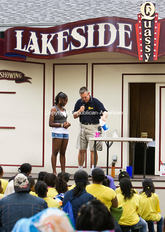 MIDDLEBURY, CT-  15 June 2010- 061610BF02- Ron Gustafson, director of public relations and educational programs at Quassy Amusement Park shows Lynthaina Paules,15, an eighth-grade student at North End Middle School in Waterbury how to make clear liquids colorful using household chemicals. The demonstration was being done as part of the Wacky Science presentation Wendesday at the park in Middlebury.  Bob Falcetti Republican-American