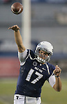 Nevada's Cody Fajardo (17) warms up before an NCAA college football game against Colorado State in Reno, Nev., on Saturday, Oct. 11, 2014. (AP Photo/Cathleen Allison)