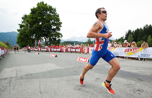 24 JUN 2012 - KITZBUEHEL, AUT - Aaron Harris (GBR) of Great Britain during the run at the elite men's 2012 World Triathlon Series round in Schwarzsee, Kitzbuehel, Austria .(PHOTO (C) 2012 NIGEL FARROW)
