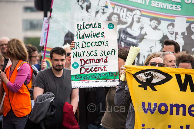 London, 04/06/2016. Today, hundreds of people, including doctors, student nurses, midwives, junior doctors and other healthcare professionals marched from the Saint Thomas Hospital to the Department of Health in Whitehall to protest against the Conservative Government's plan to scrap bursaries for nursing and midwifery students from 2017. The demonstration was organised by the &quot;NHS Bursary Cuts Forum&quot; and supported by trade unions and other organizations fighting against the plan to privatise the NHS (National Health Service).<br />  <br /> For more information please click here: https://www.facebook.com/events/1020899857963987/