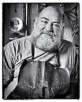 Portrait of Artist/Sculptor Jeff Rutledge, Dayton Ohio. Black & white environmental portrait in his studio
