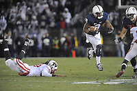 24 November 2012:  Penn State WR Allen Robinson (8) jumps over a tackle attempt by Wisconsin's Dezmen Southward (12). The Penn State Nittany Lions defeated the Wisconsin Badgers 24-21 in OT overtime at Beaver Stadium in State College, PA.