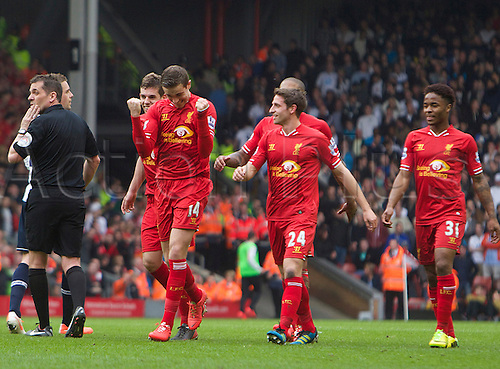 30.03.2014  Liverpool, England.   Liverpool's Jordan Henderson celebrates after being told it's his goal  and scoring to make it 4-0 during the Premier League game between Liverpool and Tottenham Hotspur from Anfield