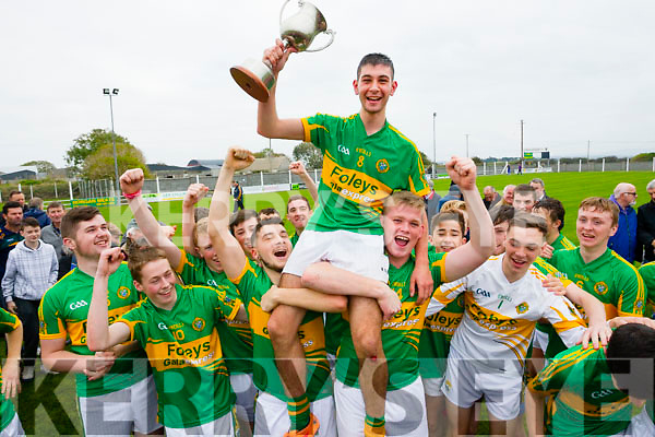 John Buckley Lixnaw captain lifts the Sean Lovett cup after winning the County Minor Hurling Final over Saint Brendans at Kilmoyley on Saturday.