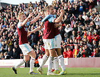 Burnley's Dwight McNeil is mobbed by team-mates as he celebrates scoring his side's second goal <br /> <br /> Photographer Rich Linley/CameraSport<br /> <br /> The Premier League - Burnley v Wolverhampton Wanderers - Saturday 30th March 2019 - Turf Moor - Burnley<br /> <br /> World Copyright © 2019 CameraSport. All rights reserved. 43 Linden Ave. Countesthorpe. Leicester. England. LE8 5PG - Tel: +44 (0) 116 277 4147 - admin@camerasport.com - www.camerasport.com