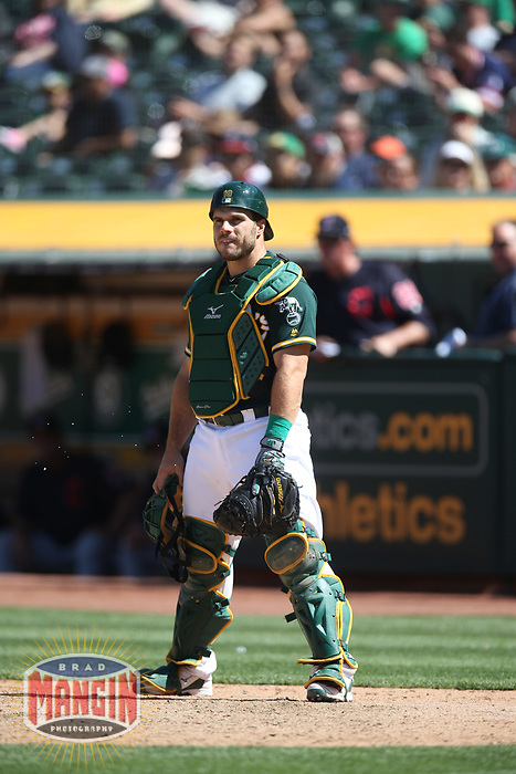 OAKLAND, CA - JUNE 30:  Josh Phegley #19 of the Oakland Athletics works behind the plate against the Cleveland Indians during the game at the Oakland Coliseum on Saturday, June 30, 2018 in Oakland, California. (Photo by Brad Mangin)