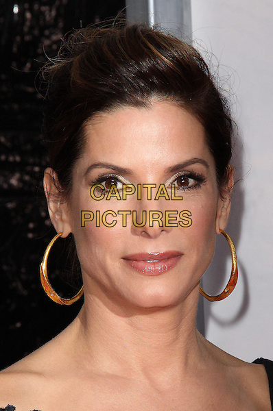 "SANDRA BULLOCK.At the New York City Premiere of ""The Blind Side"" held at the Ziegfeld Theater, New York, NY, USA, .17th November 2009..portrait headshot hair up hoop earrings gold .CAP/ADM/PZ.©Paul Zimmerman/AdMedia/Capital Pictures."