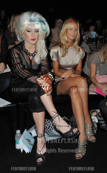 Jodie Harsh and Lady Victoria Hervey on the front row of Ashish fashion show, part of London Fashion Week, London. 21/09/2010  Picture by: Simon Burchell / Featureflash