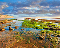 Rock pools on the beach of the historic fishing village of Robin Hood's Bay, Near Whitby, North Yorkshire, England.