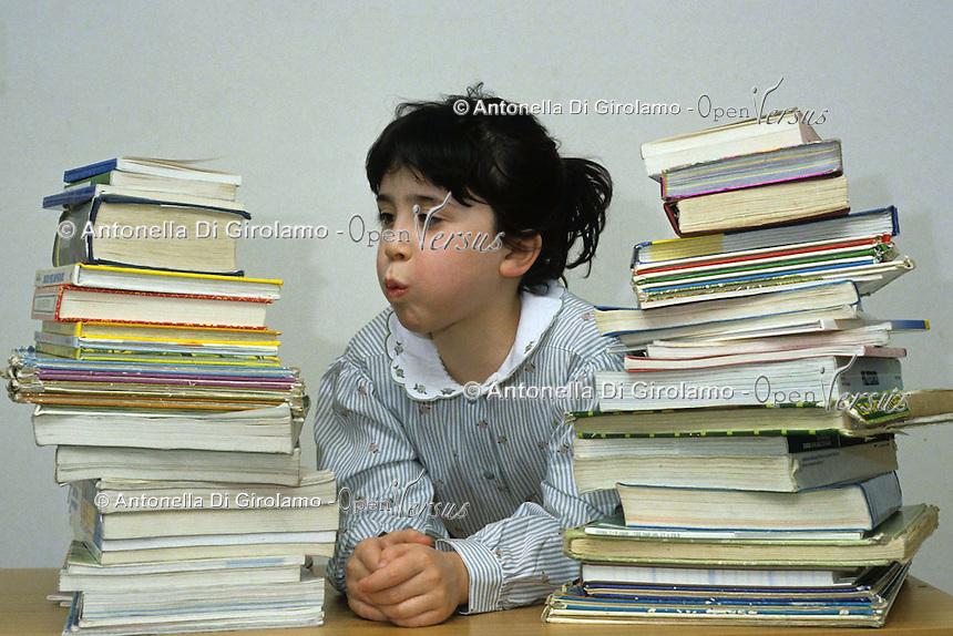 Bambina e libri. Baby-girl and books....