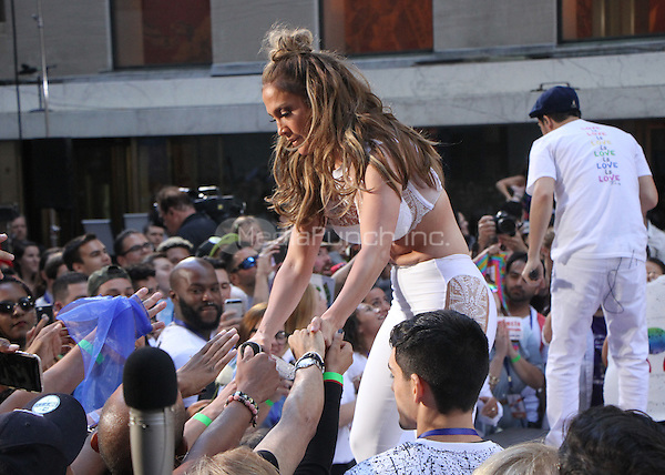 NEW YORK, NY-July 11: Jennifer Lopez & Lin-Manuel Miranda  perform a Orlando tribute song Love Make the World Go Round on NBC's Today Show Citi Concert Series at Rockefeller Center in New York. NY July 11, 2016. Credit:RW/MediaPunch