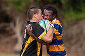 Robert Wallis & Jerry Cagica come together in a close embrace. Counties Manukau Premier Club Rugby game between Patumahoe  and Bombay played at Patumahoe on Saturday 24th April 2010..Patumahoe won 52 - 5 after leading 26 - 0 at halftime.