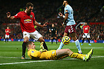 Tom Heaton of Aston Villa spills the ball for a corner under pressure from Juan Mata of Manchester United during the Premier League match at Old Trafford, Manchester. Picture date: 1st December 2019. Picture credit should read: Phil Oldham/Sportimage
