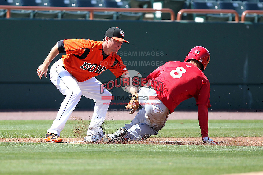 Bowie BaySox third baseman Buck Britton #5 attempts to tag Jeff Kobernus #8 sliding in safely during a game against the Harrisburg Senators at Prince George's Stadium on April 8, 2012 in Bowie, Maryland.  Harrisburg defeated Bowie 5-2.  (Mike Janes/Four Seam Images)