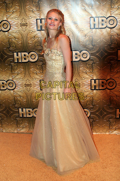 EMILIE DE RAVIN.HBO Golden Globe Party After Party held at the Aqua Star Pool in the Beverly Hilton Hotel, Beverly Hills, California..Jnuary 16th, 2006.Photo: Zach Lipp/AdMedia/Capital Pictures.Ref: ZL/ADM.full length strapless cream gold sheer sequin sparkly dress.www.capitalpictures.com.sales@capitalpictures.com.© Capital Pictures.