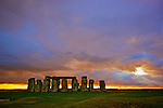 The neolithic monument Stonehenge beneath a winter sky, at sunset, just days from the solstice. It is visited by thousands of tourists each year and its mystery is still being uncovered.