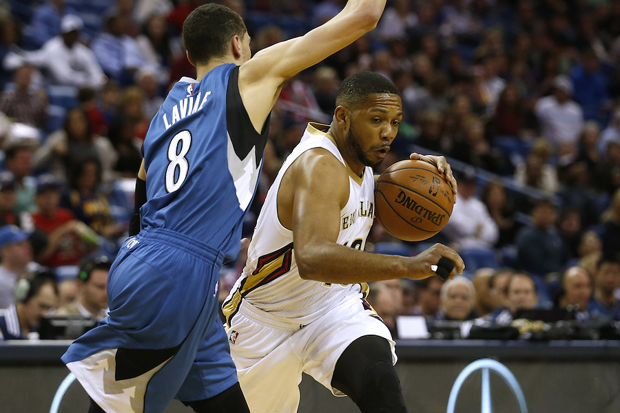 New Orleans Pelicans guard Eric Gordon (10) drives against Minnesota Timberwolves guard Zach LaVine (8) during the first half of an NBA basketball game Saturday, Feb. 27, 2016, in New Orleans. (AP Photo/Jonathan Bachman)