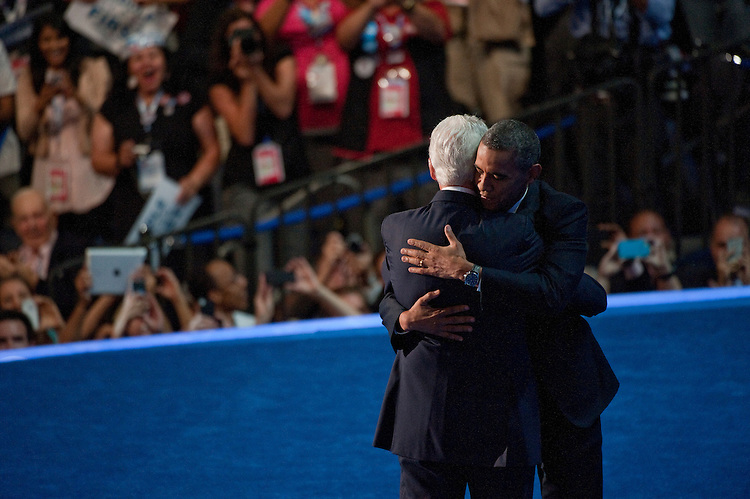 UNITED STATES - September 5: Former U.S. President Bill Clinton hugs Democratic presidential candidate, U.S. President Barack Obama (R) on stage during day two of the Democratic National Convention at Time Warner Cable Arena on September 5, 2012 in Charlotte, North Carolina. The DNC that will run through September 7. The Convention nominated U.S. President Barack Obama as the Democratic presidential candidate. (Photo By Douglas Graham/CQ Roll Call)