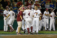 South Carolina's Robert Beary scores the game tying run in the 8th inning and is greeted at home by Whit Merrifield (5) in Game Two of the NCAA Division One Men's College World Series Finals on June 29th, 2010 at Johnny Rosenblatt Stadium in Omaha, Nebraska.  (Photo by Andrew Woolley / Four Seam Images)