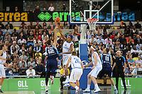 GB's Kieron Achara block Mirza Teletovic of Bosnia & Herzegovina during the EuroBasket 2015 2nd Qualifying Round Great Britain v Bosnia & Herzegovina (Euro Basket 2nd Qualifying Round) at Copper Box Arena in London. - 13/08/2014