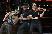 WEST PALM BEACH, FL - SEPTEMBER: 22: Matt Mangano,  Zac Brown and Jimmy De Martini of the Zac Brown Band perform at The Coral Sky Amphitheatre on September 22, 2017 in West Palm Beach Florida. Credit Larry Marano © 2017