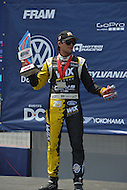 Washington, DC - June 22, 2014: Nelson Piquet, Jr. holds his 2nd Place trophy for his finish in the supercar final at the inaugural Red Bull Global Rallycross on the grounds of RFK Stadium in the District of Columbia, June 22, 2014.   (Photo by Don Baxter/Media Images International)