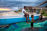A fisherman's family on the tiny island of Gili Air, Indonesia.