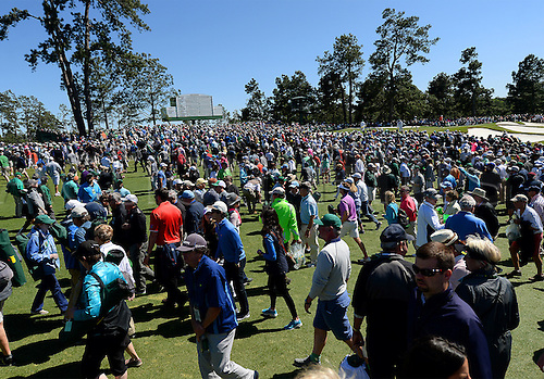 09.04.2016. Augusta, GA, USA.  Patrons of Augusta National Golf Club mill between greens during third-round action in the 80th Masters on Saturday, April 9, 2016, in Augusta, Ga