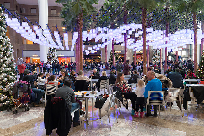Visitors and shoppers sit in the atrium of Brookfield place in Battery Park City during the holiday season in New York City.
