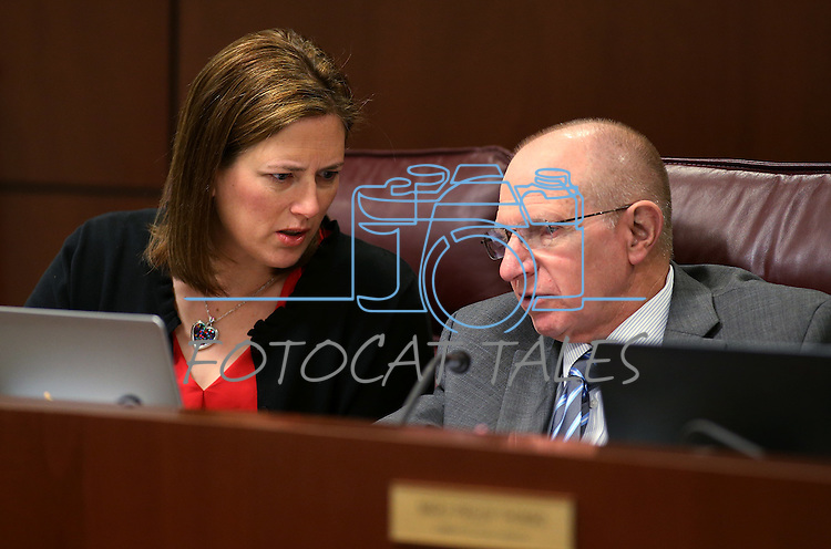 Nevada Senate Republicans Becky Harris and Joe Hardy work in committee at the Legislative Building in Carson City, Nev., on Wednesday, April 29, 2015. <br /> Photo by Cathleen Allison