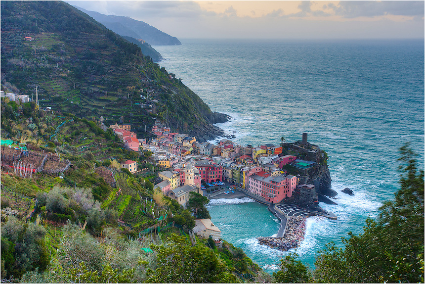 Looking down at Vernazza in this Cinque Terre Image, you can see the quaint small fishing village and how it is placed along the Italian Coast of the Ligurian Sea. I awoke early on this morning and hiked up before sunrise to capture this picture of one of my favorite places in the world...Vernazza was devastated by a flood in 2010, but has slowly recovered, rebuilding and replenishing all that makes it a great place to visit.