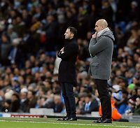 Manchester City manager Josep Guardiola (right) and FC Schalke 04 manager Domenico Tedesco watch on from their technical areas<br /> <br /> Photographer Rich Linley/CameraSport<br /> <br /> UEFA Champions League Round of 16 Second Leg - Manchester City v FC Schalke 04 - Tuesday 12th March 2019 - The Etihad - Manchester<br />  <br /> World Copyright &copy; 2018 CameraSport. All rights reserved. 43 Linden Ave. Countesthorpe. Leicester. England. LE8 5PG - Tel: +44 (0) 116 277 4147 - admin@camerasport.com - www.camerasport.com