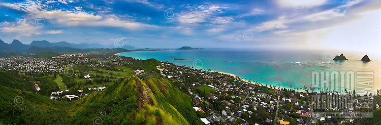Sunrise over Windward O'ahu as seen from the Lanikai Pillboxes (or Ka'iwa Ridge Trail), with a view of the Mokulua Islands or Islets, Kailua Bay, Kane'ohe and more.
