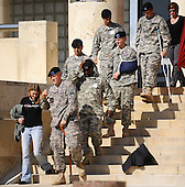 Fort Hood, TX - November 10, 2009 -- Soldiers wounded in the Fort Hood shooting arrive at the memorial service for the 12 soldiers and one civilian killed at Fort Hood U.S Army Post near Killeen, Texas, USA 10 November 2009. Army Major Malik Nadal Hasan reportedly shot and killed 13 people, 12 soldiers and one civilian, and wounded 30 others in a rampage 05 November at the base's Soldier Readiness Center where deploying and returning soldiers undergo medical screenings.  .Credit: Tannen Maury / Pool via CNP