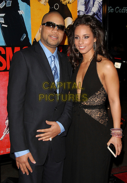KERRY KRUCIAL BROTHERS & ALICIA KEYS.The Universal Pictures' World Premiere of Smokin' Aces held at The Grauman's Chinese Theatre in Hollywood, California on.January 18th, 2007.half length black dress low cut plunging neckline lace suit  detail halterneck clutch purse sunglasses shades.CAP/DVS.©Debbie VanStory/Capital Pictures