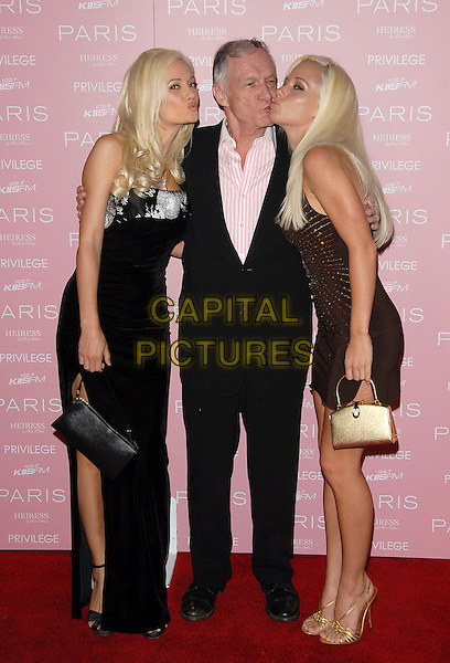 HOLLY MADISON, HUGH HEFNER & KENDRA WILKINSON.At The Paris Hilton CD Release Party held at Privelege in West Hollywood, California, USA, August 18, 2006..full length kissing cheek girls girlfriends blondes playboy.Ref: DVS.www.capitalpictures.com.sales@capitalpictures.com.©Debbie VanStory/Capital Pictures