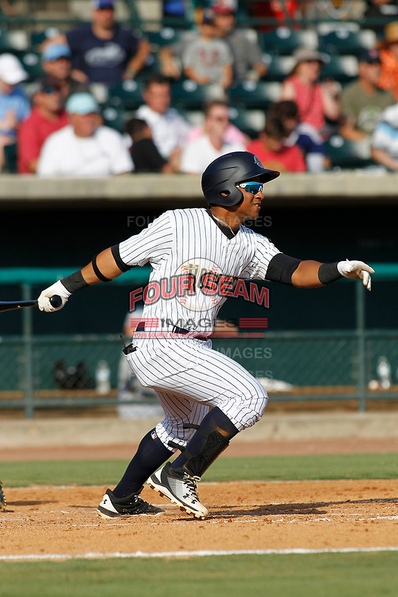 "Charleston Riverdogs designated hitter Frederick Cuevas (8) at bat during a game against the Hickory Crawdads at the Joseph P. Riley Ballpark in Charleston, South Carolina. For Sunday games, the Riverdogs wear their ""Holy City"" uniforms in honor of the city's nickname. Hickory defeated Charleston 8-7. (Robert Gurganus/Four Seam Images)"
