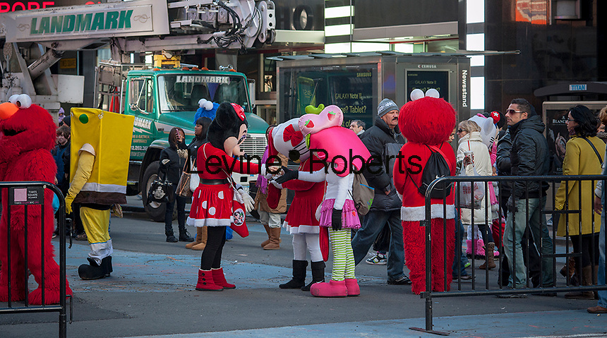 "Costumed characters swarm Times Square in New York on Friday, December 28, 2012. The ""actors"" pose for photographs with tourists asking for tips as remuneration. Recently a number of them have been embroiled in controversy for groping women and anti-semitic ranting. Otherwise they just aggressively come up to people soliciting photos. (© Richard B. Levine)"