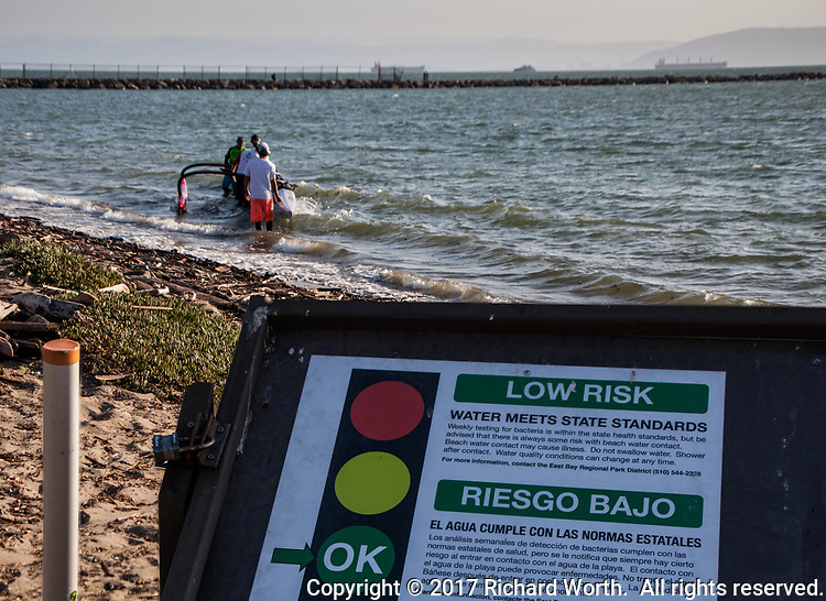 When you're standing around in the water, preparing to launch your outrigger canoe, it's nice to know the water quality is OK.  Encinal Beach in Alameda, California, on San Francisco Bay.