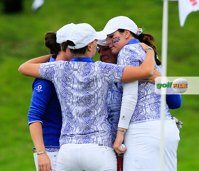 Team huddle with Olivia Mehaffey after her match finished A/S after the Sunday Singles matches at the 2016 Curtis cup from Dun Laoghaire Golf Club, Ballyman Rd, Enniskerry, Co. Wicklow, Ireland. 12/06/2016.<br /> Picture Fran Caffrey / Golffile.ie<br /> <br /> All photo usage must carry mandatory copyright credit (&copy; Golffile | Fran Caffrey)